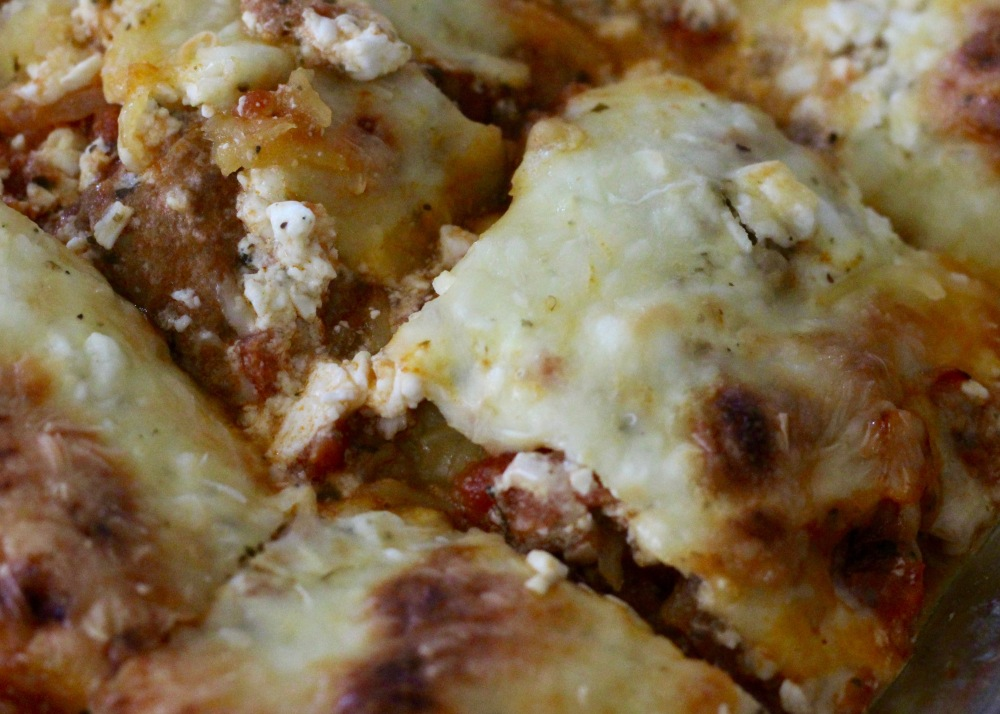 Close up of low carb spaghetti squash lasagna cut in squares