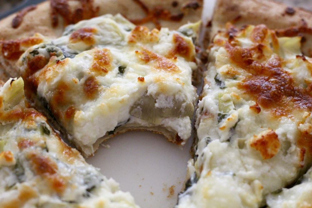 Bite out of Spinach & Artichoke Dip Pizza